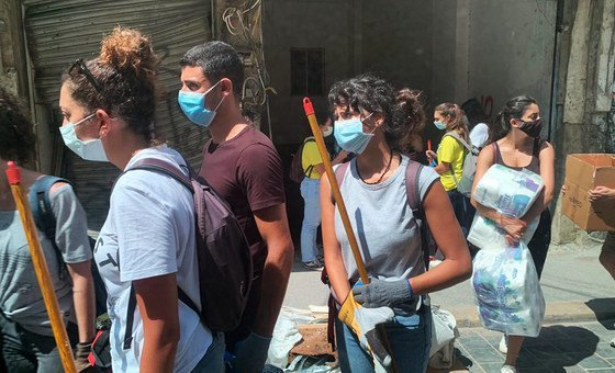 Youth volunteers help to clear the rubble clean-up in Mar-Mikhael, one of the areas worst hit by the blast.