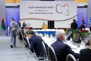 A member of the Libyan Political Dialogue Forum (LPDF) casts her vote during the elections for the interim leadership.