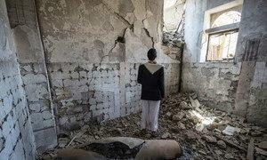 A local man stands next to a missile casing in a former government building in Saada City, Yemen. (file)