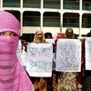 Women in Bangladesh stand up for gender equality.