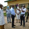 People prepare to visit at a Kinshasa prison in the Democratic Republic of the Congo during COVID-19 pandemic.