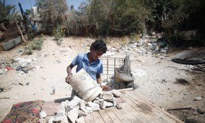 Thirteen-year-old boy in Palestine collects rubble near Gaza City, which he transports by donkey to the market to sell. (file)