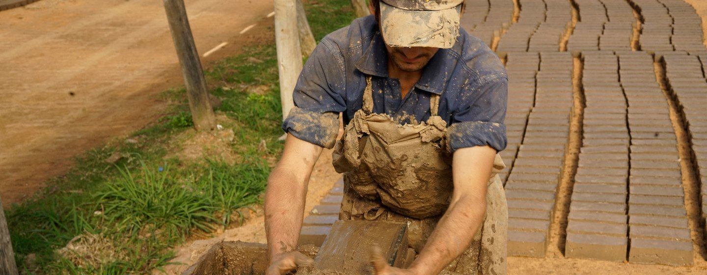 Artisanal brickmakers in Uruguay put the raw material into a mold, and then lay it out to dry.