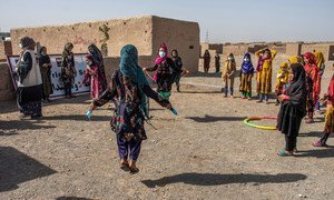 Young girls play at a child friendly space for displaced people at settlement in the outskirts of Herat city in Afghanistan.