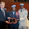 From left, UN Under-Secretary-General for Peacekeeping Operations, Jean-Pierre Lacroix, UN Female Police Officer of the Year Major Seynabou Diouf and MONUSCO Police Commission Awale Abdounasir at the award ceremony. (5 November 2019)