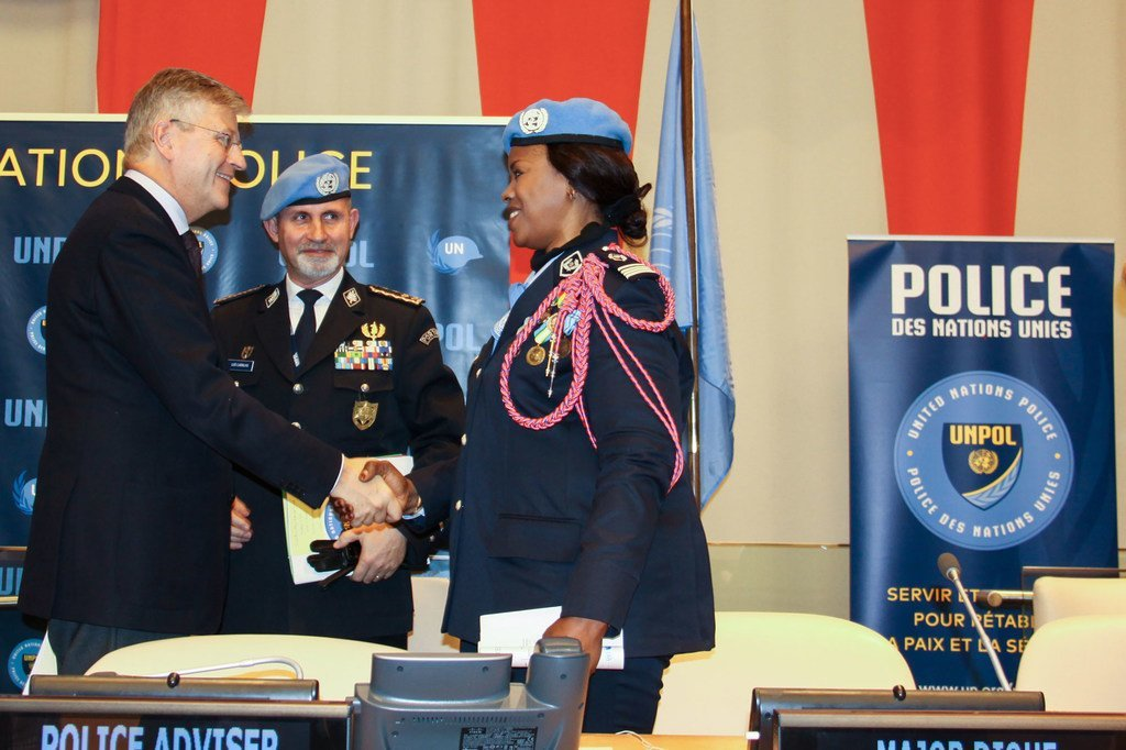 Police Commissioner Luis Carrilho looks on as UN Under-Secretary-General for Peacekeeping Operations, Jean-Pierre Lacroix, shakes the hand of Major Seynabou Diouf, UN Female Police Officer of the Year. (5 November 2019)