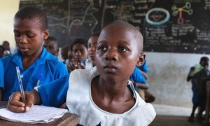 A child sits at her desk at a UNICEF-supported government primary school, in Douala, Cameroon.