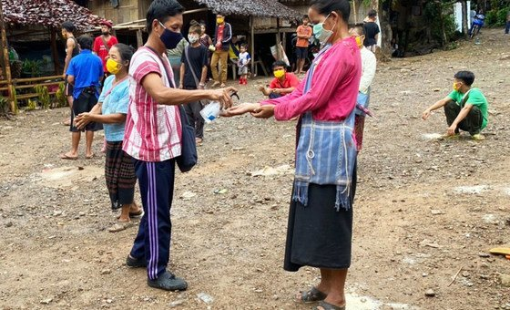 Myanmar refugees share hand sanitiser at Mae Ra Ma Luang temporary shelter in Thailand.