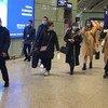 Des voyageurs portant des masques à l'aéroport international de Chengdu Shuangliu, en Chine.