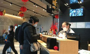 People wear face masks at China's Chengdu Shuangliu International Airport.
