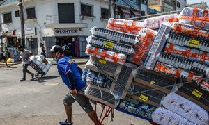 Goods are transported by hands in Lima, Peru.