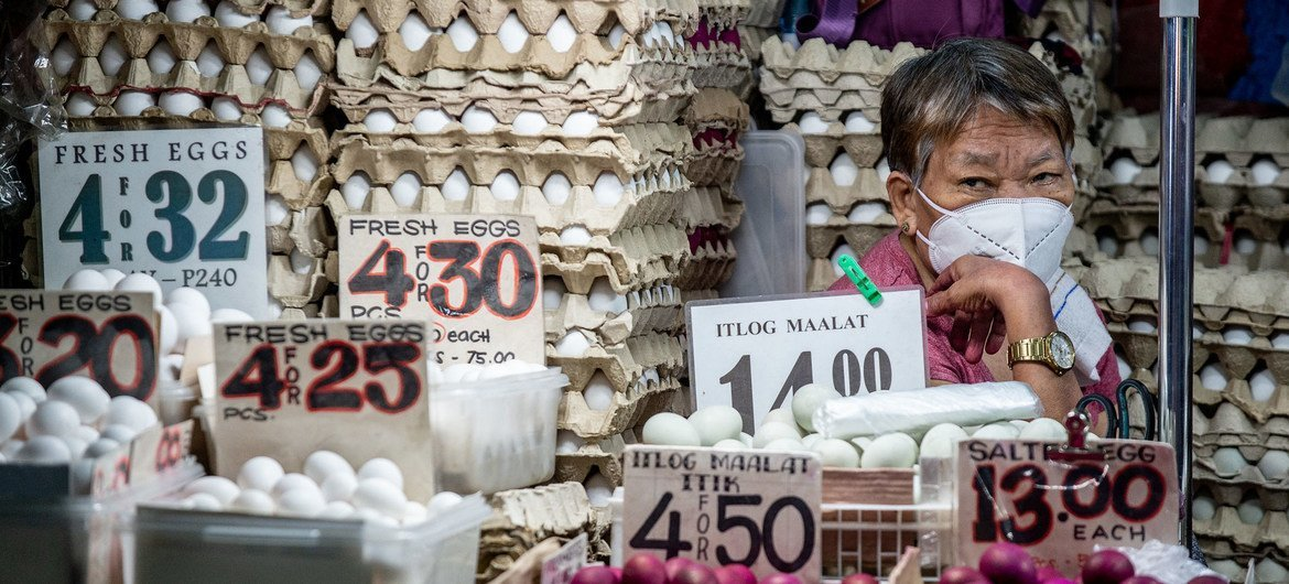 An egg vendor sits in her stall in Quiapo, Philippines.