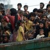 Stranded Rohingya people sit on the deck of an abandoned smugglers' boat drifting in the Andaman Sea in  2015.