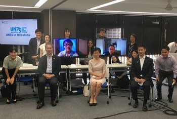 The UN Under-Secretary-General of Disarmament Affairs Izumi Nakamitsu (centre) meets young people in Japan at an event focused on the 75th anniversary of the nuclear bombing of Hiroshima and the establishment of the UN.