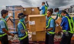 COVID-19 test kits arrive at Yangon airport in Myanmar in June 2020.