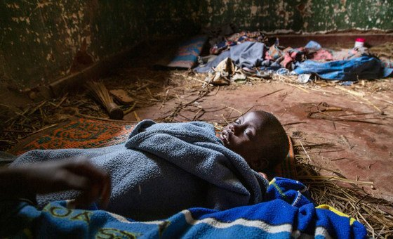 A five-year-old girl sleeps on the brick floor of a colonial era building taken over by displaced families in the Izinga camp in Boga, DR Congo.