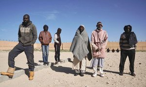 At the Qanfoodah Detention Centre in Benghazi, Libya, male African detainees wait to be declared present at a morning roll call.