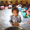 Local school children eat their meals at a primary school in Xay District, Lao PDR.