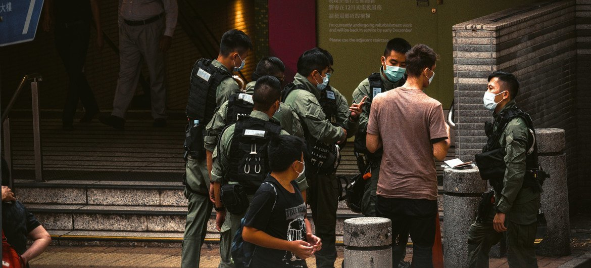 Police officers in Hong Kong meet on the streets of the city in October, 2020.
