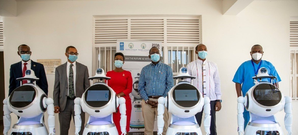 Stephen Rodriques, (2nd left) UNDP Rwanda Resident Representative pose for a group photo with Rwanda government officials as well representative of Zorabots, after handing over the robots in Kigali.