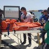 The only survivor among passengers on a boat adrift off the West African coast is transported to an ambulance in Nouadhibou, Mauritania.