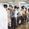 Migrants line up at the airport in Aden, Yemen, for a flight which will take them to Ethiopia.