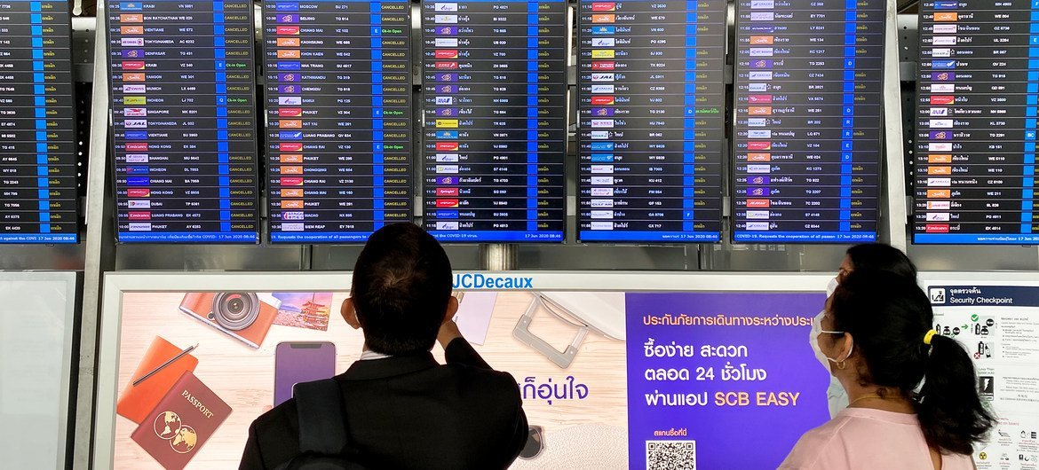 Passengers try to find their flight in the midst of the coronavirus pandemic at Bangkok's Suvarnabhumi Airport. Several flights have been cancelled as countries closed their borders to contain the spread of COVID-19.