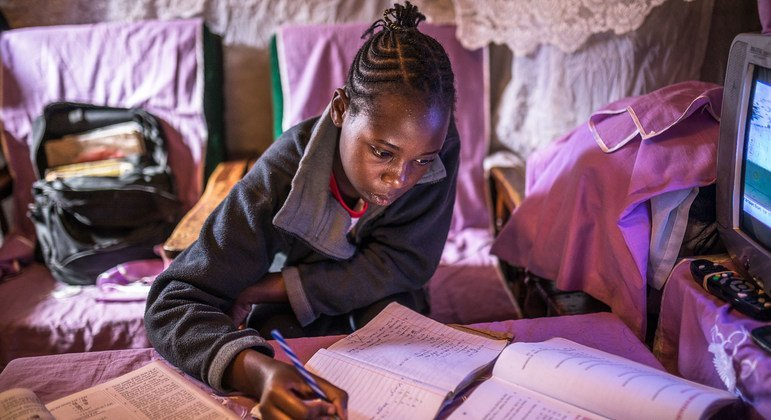 A young Kenyan girl studies at home in Nairobi during the COVID-19 pandemic.