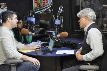 Fabrizio Hochschild, Special Adviser on Preparations for Seventy-Fifth United Nations Anniversary, in the UN News Studio at UN Headquarters in New York, with the UNcomplicated hosts, Sinduja Srinivasan and Jason DeWall.