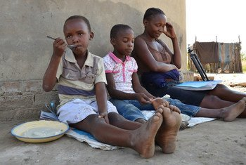 A mother homeschools her children in Shamva district, Zimbabwe, during the  COVID-19 pandemic.