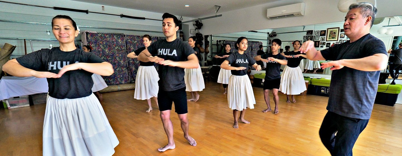 Michael Pili Pang (right) runs a hula dance school in Honolulu, Hawaii