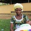 Jane Nyarugendo avec son bébé dans le camp de réfugiés de Kyangwali en Ouganda.