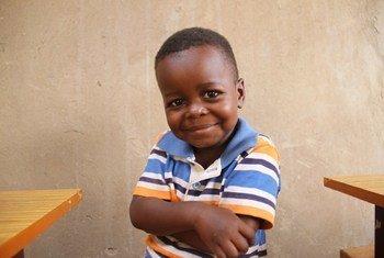 Picha ya mtoto mwenye furaha akiwa kwenye kituo cha kulea watoto kilichoko wilaya ya Iganga nchini Uganda.