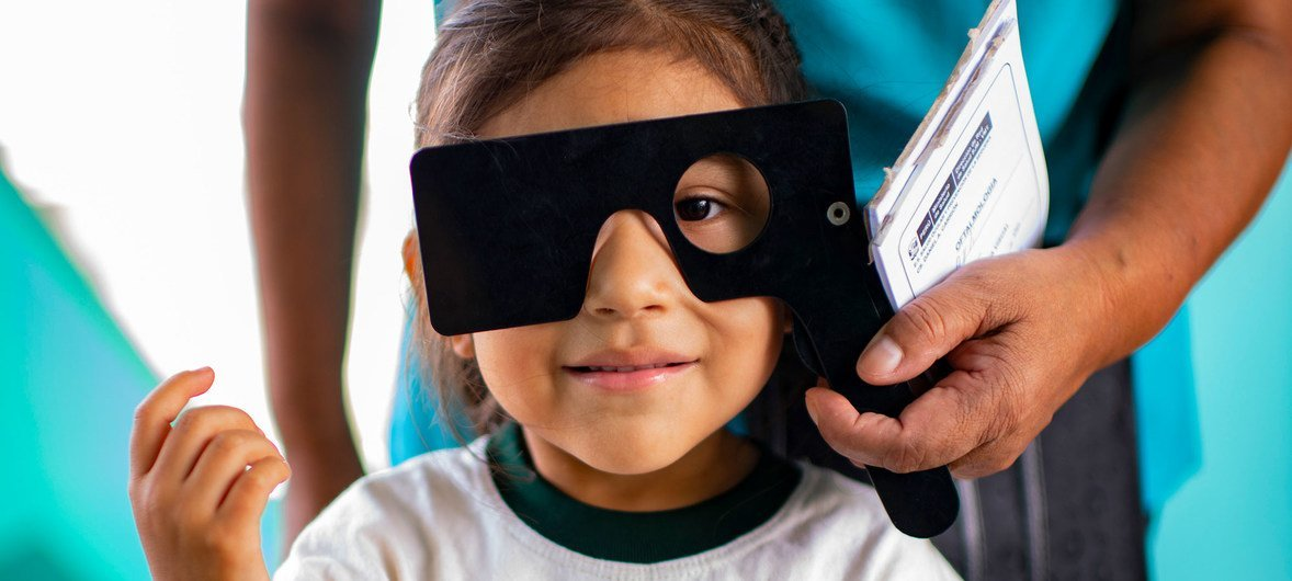 A little girl gets a visual examination at her school in Lima, Peru. (March 2018)