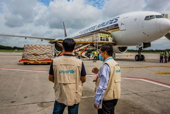 UNICEF Myanmar staff check cargo of PPE supplied by UNICEF at Yangon International airport, Myanmar.