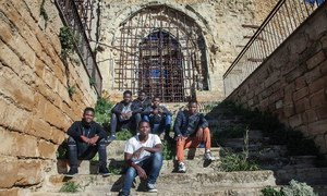 Omar (17), far right on second row, and other unaccompanied migrant boys at an abandoned church in Sicily, Italy. Most of them were transferred without a choice to this very small village.