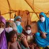 Migrant women and their children quarantine at a site in Niamey, Niger.
