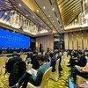Des scientifiques de l'Organisation mondiale de la santé s'expriment lors d'une conférence de presse à Wuhan, en Chine.
