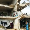 Sixteen families live in a damaged school in Binish, a city in northwest Syria.