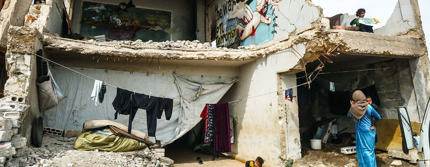 Sixteen families live in a damaged school in Syria.