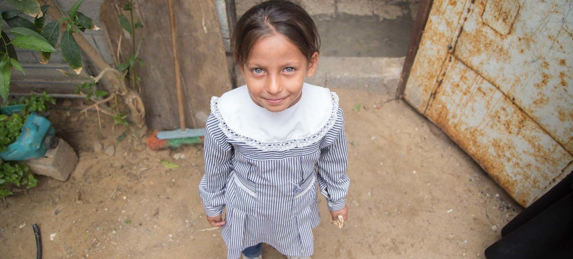 A girl stands in front of her home in Khan Younis Palestine refugee camp in Gaza.