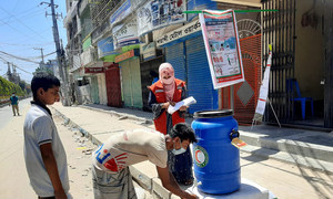 Bangladesh Red Crescent Society's staff and volunteers promote hand washing, spray disinfectant and provide emergency food, to fight against COVID-19.