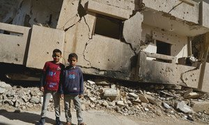 Young boys stand in front of a destroyed building in Benghazi Old Town in Libya. (file)