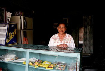 A seasonal worker at a store in Buga, Colombia.
