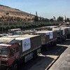 Грузовики с продовольственной помощью пересекают турецкую границу в Сирию. (фото из архива)