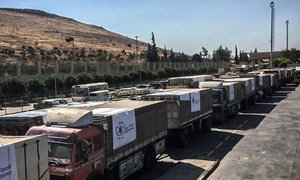 Trucks carrying food assistance cross the Turkish border into Syria. (file photo)