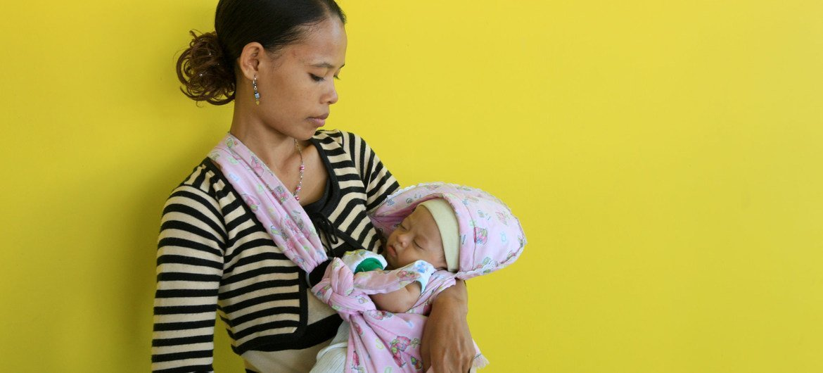 A mother and her newborn in Suai, Timor-Leste.