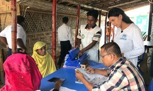 A UNHCR officer helps register Rohingya refugees in Kutupalong Refugee Camp in Cox's Bazar, Bangladesh. (24 July 2019)