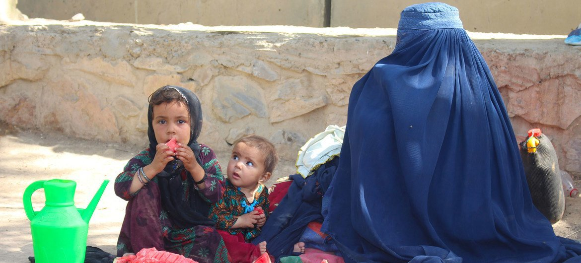 A mother and her children fled conflict in Lashkargah and now live in a displaced persons camp in Kandahar, southern Afghanistan.
