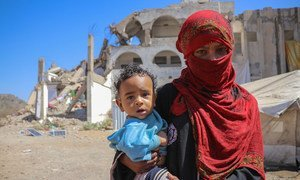 A mother holds her child in the Al Dhale'e Internally Displaced Persons (IDPs) Camp in Yemen.
